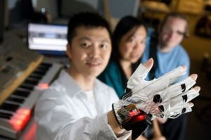 researcher with robotic hand